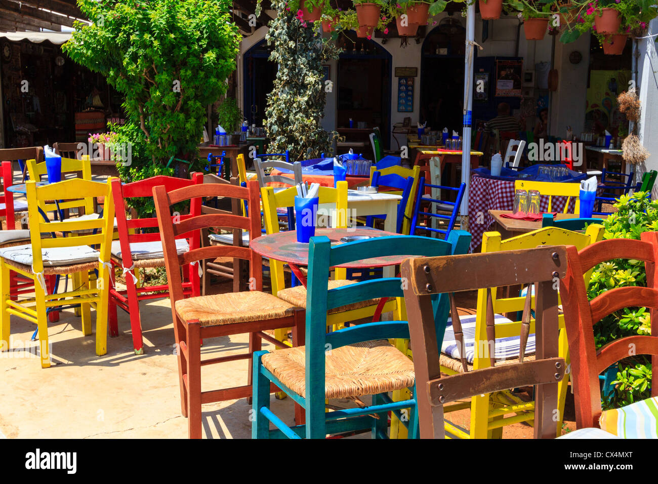 A Restaurant With Typical Colorful Chairs In Agios Nikolaos, Crete, Greece