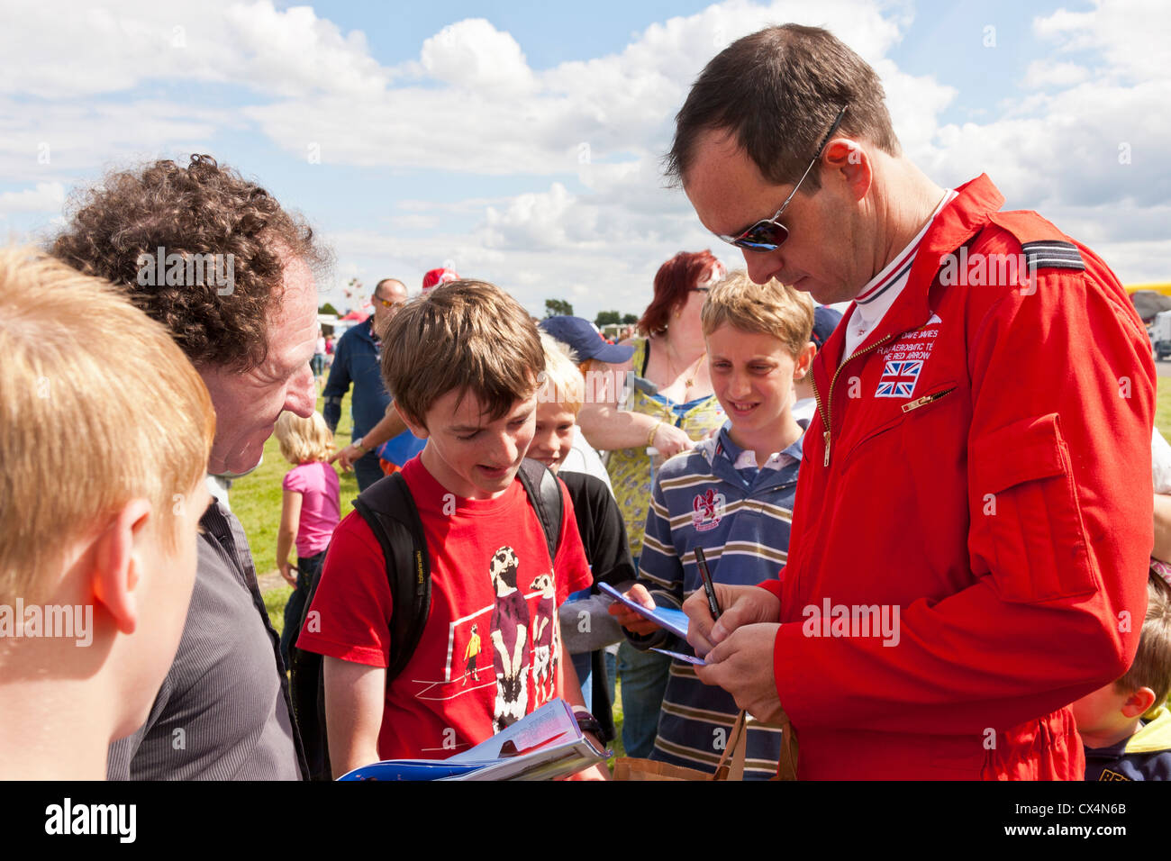 Dave Davies of the RAF Red Arrows team signing autographs at Best of British Show, Cotswold (Kemble EGBP) Airport. - Stock Image