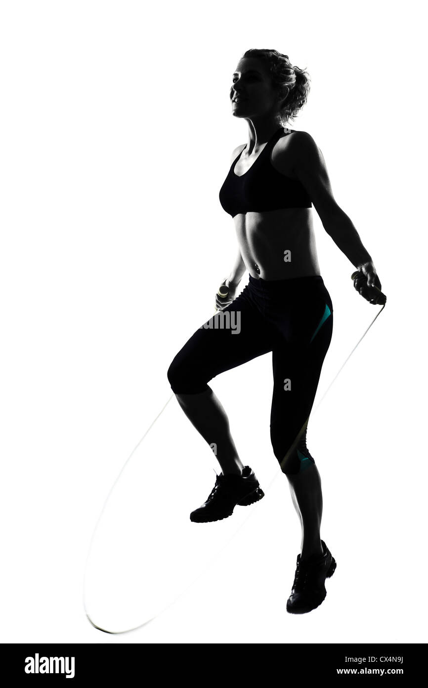 woman workout fitness posture body building jumping rope exercise exercising on studio isolated white background - Stock Image