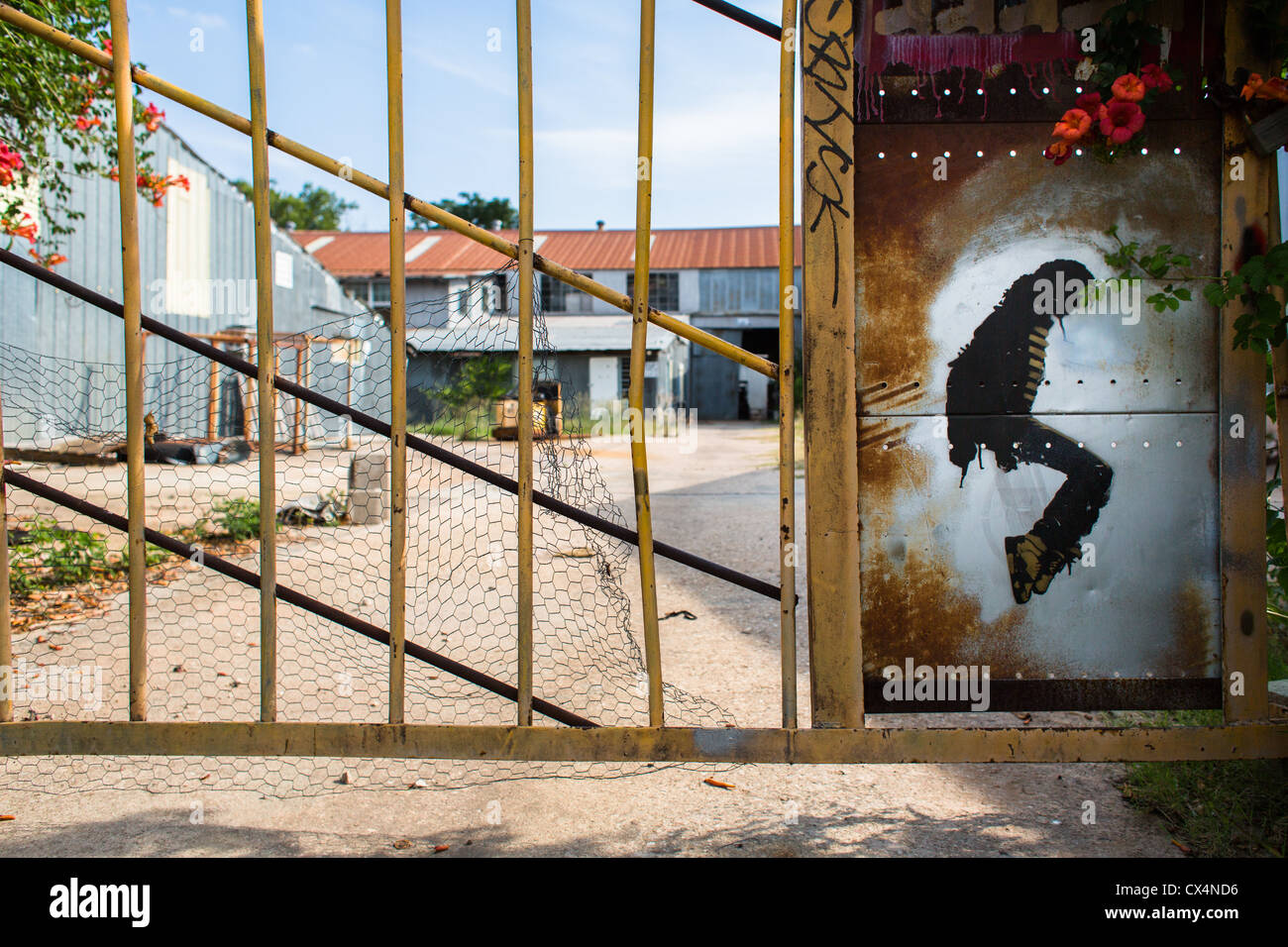 Michael Jackson stencil graffiti on an iron gate in east Austin, Texas - Stock Image