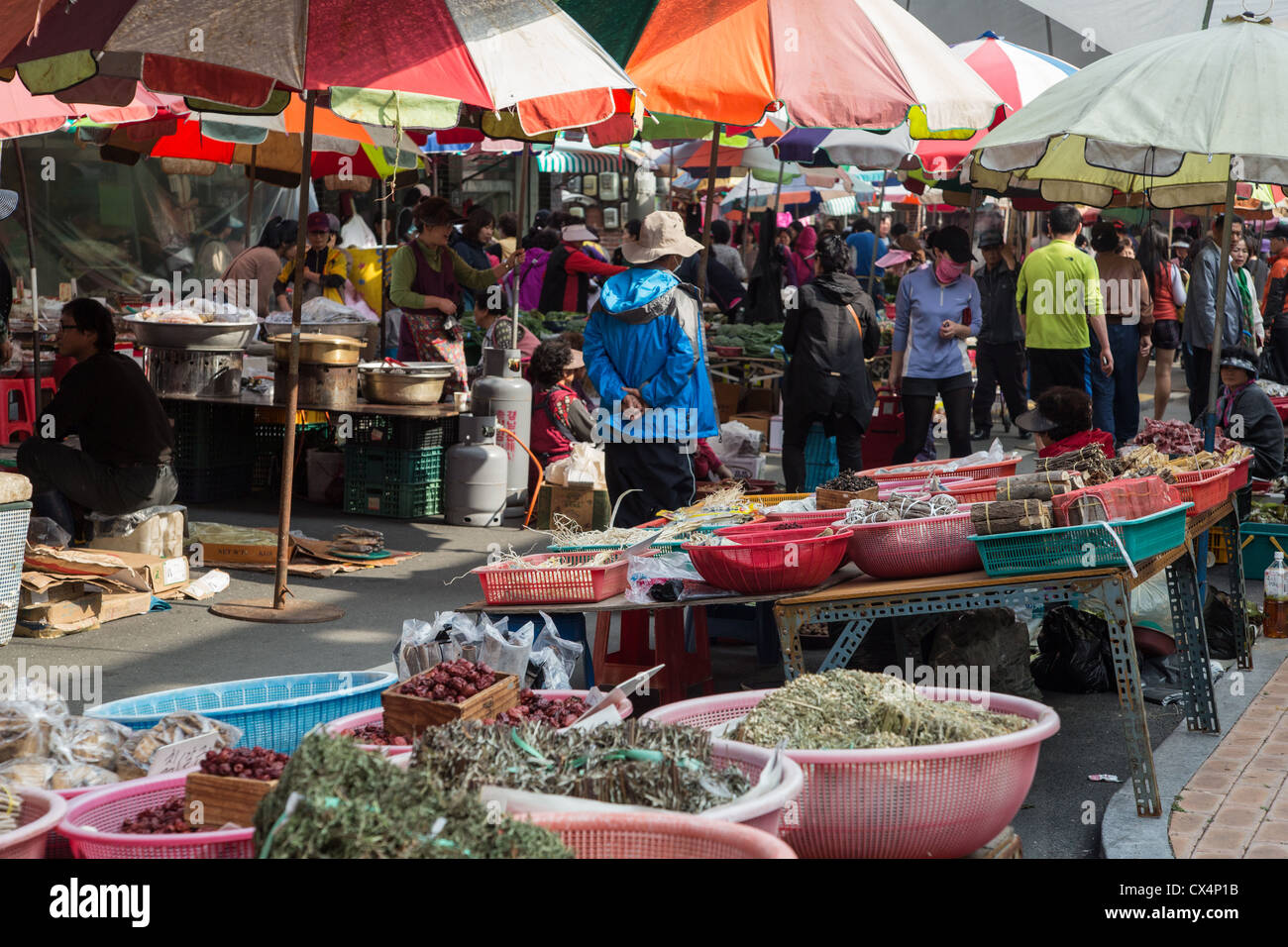 Colorful umbrellas and street vendors in the open air ...