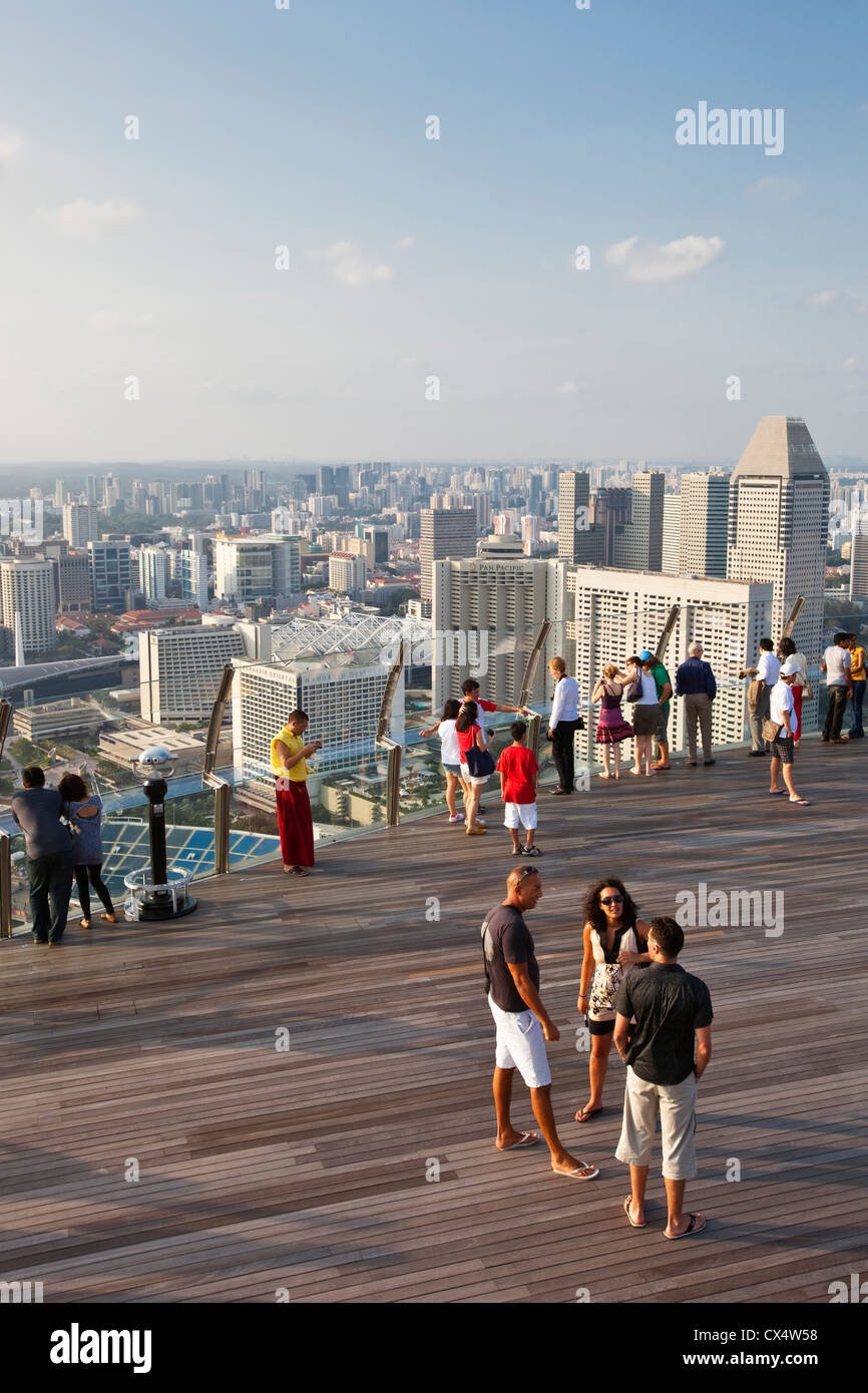 Tourists on the observation deck of the Marina Bay Sands SkyPark. Marina Bay, Singapore - Stock Image