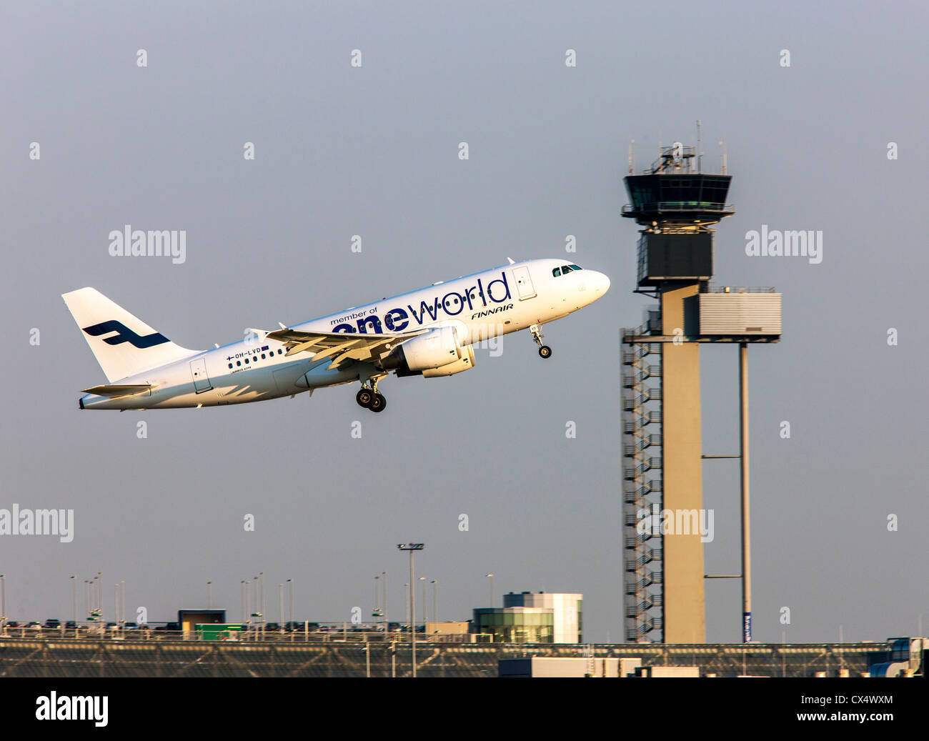 Airplane is taking off from a runway at Düsseldorf International Airport. Air traffic control tower. Düsseldorf, - Stock Image
