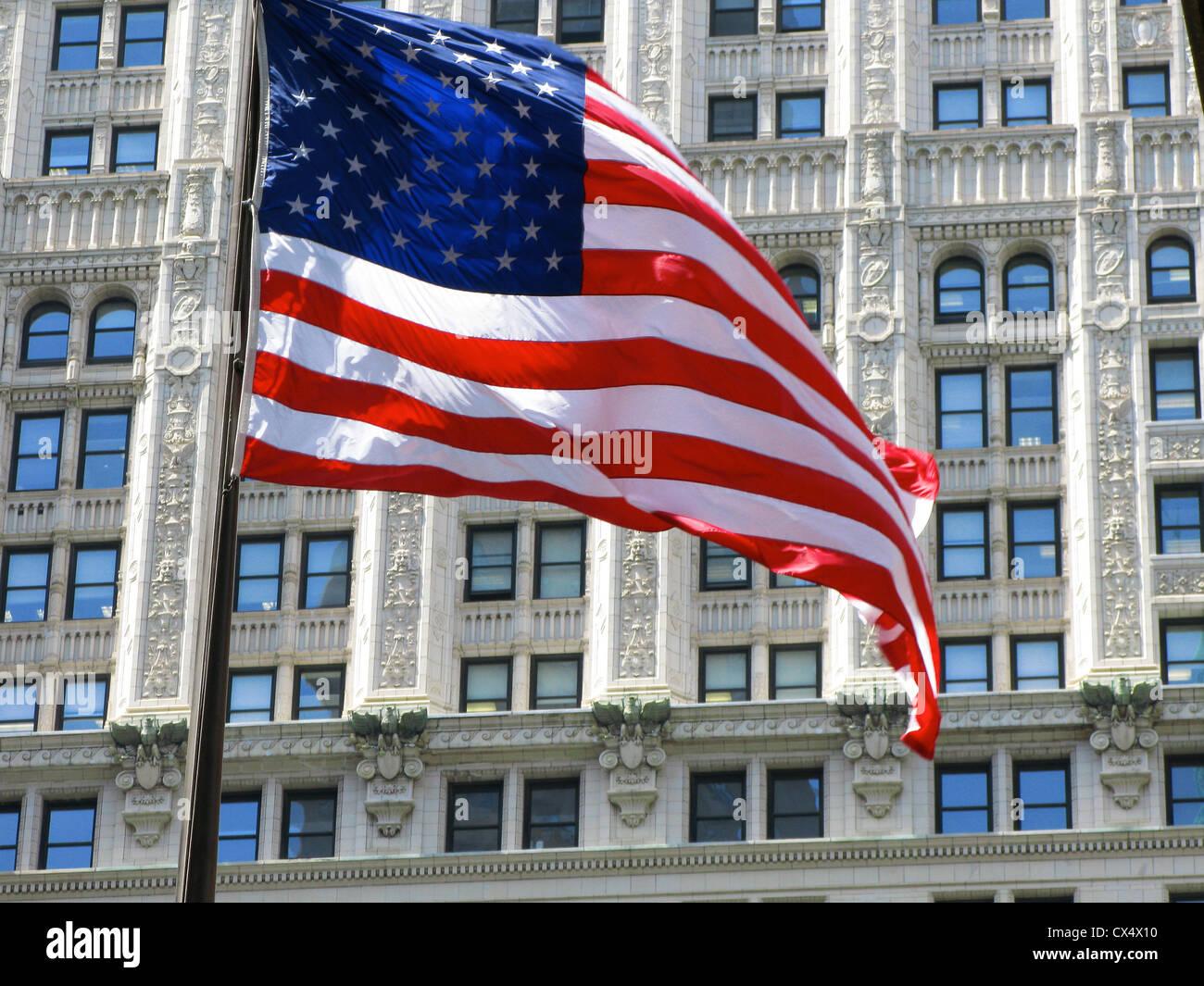 Stars and stripes, US flag flying, on flagpole, Broadway, New York. - Stock Image