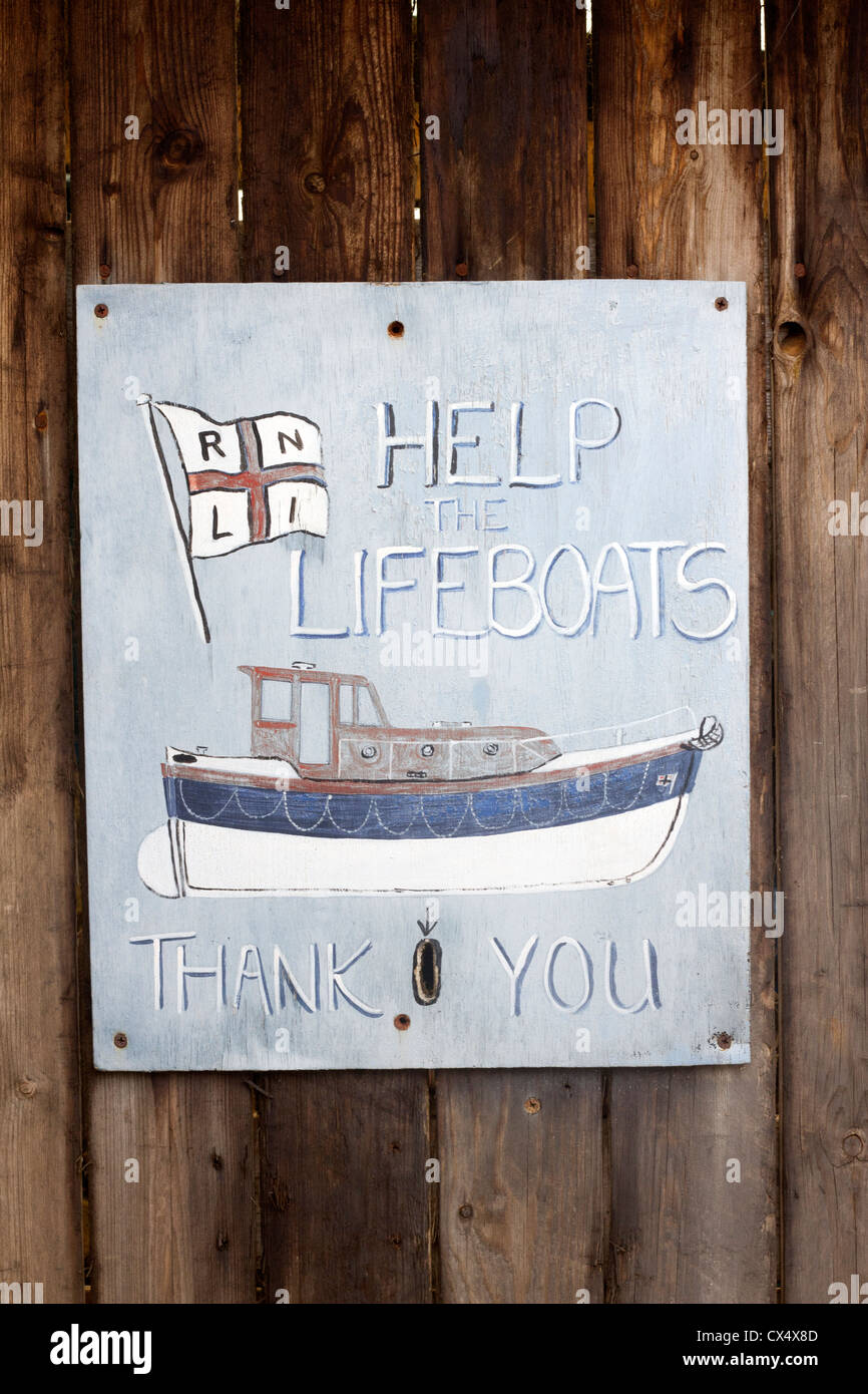 A home-made collection box for the RNLI. - Stock Image