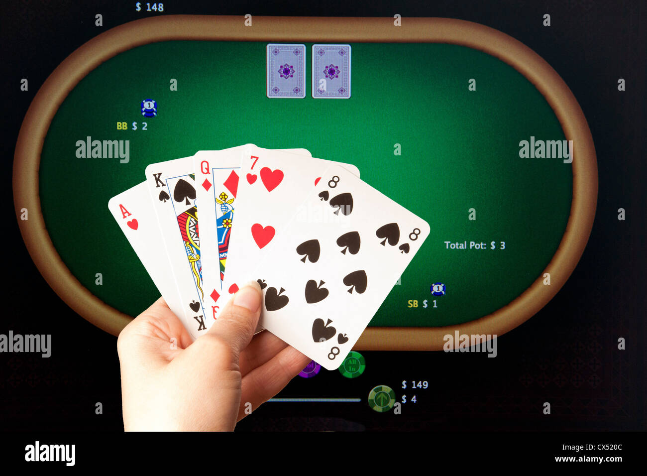 woman playing poker online - Stock Image