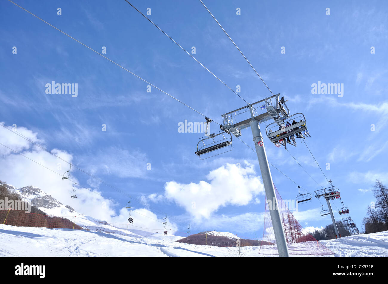 chairlifts carrying skiers to the slopes Stock Photo