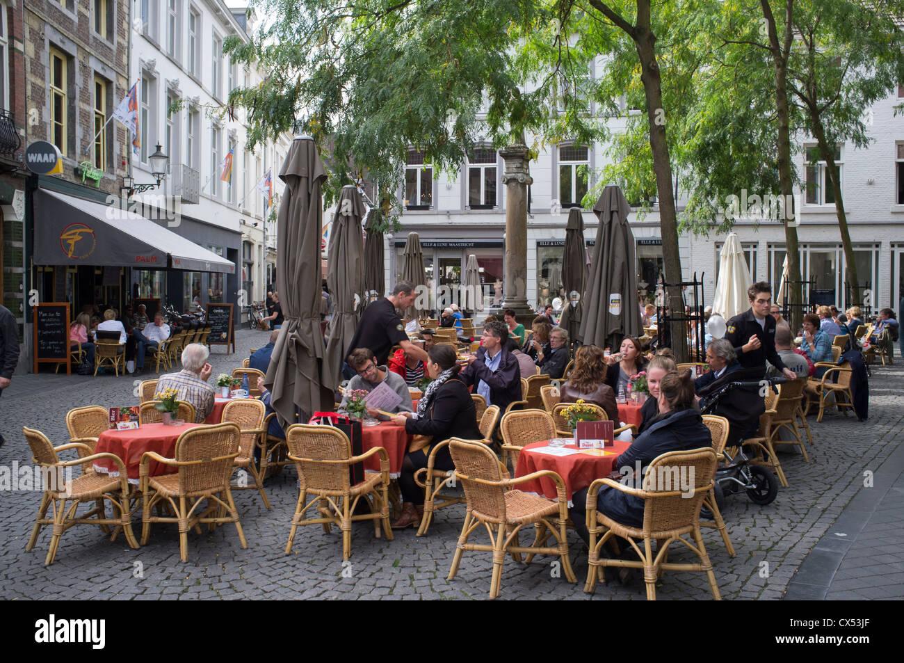 Busy cafes in pretty square in Maastricht Netherlands - Stock Image