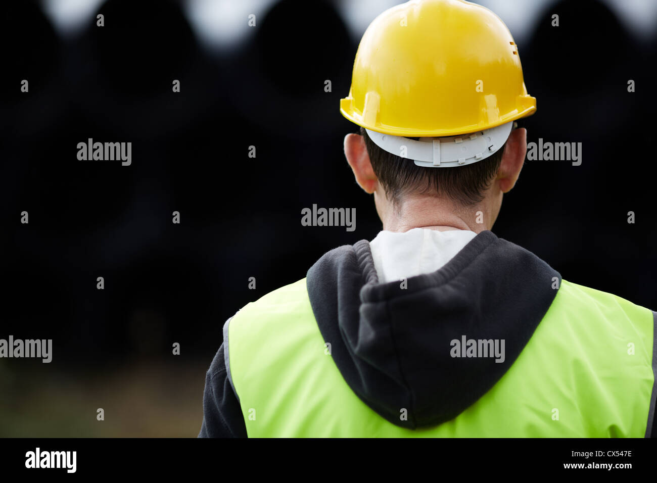 builder with yellow hard hat, selective focus - Stock Image