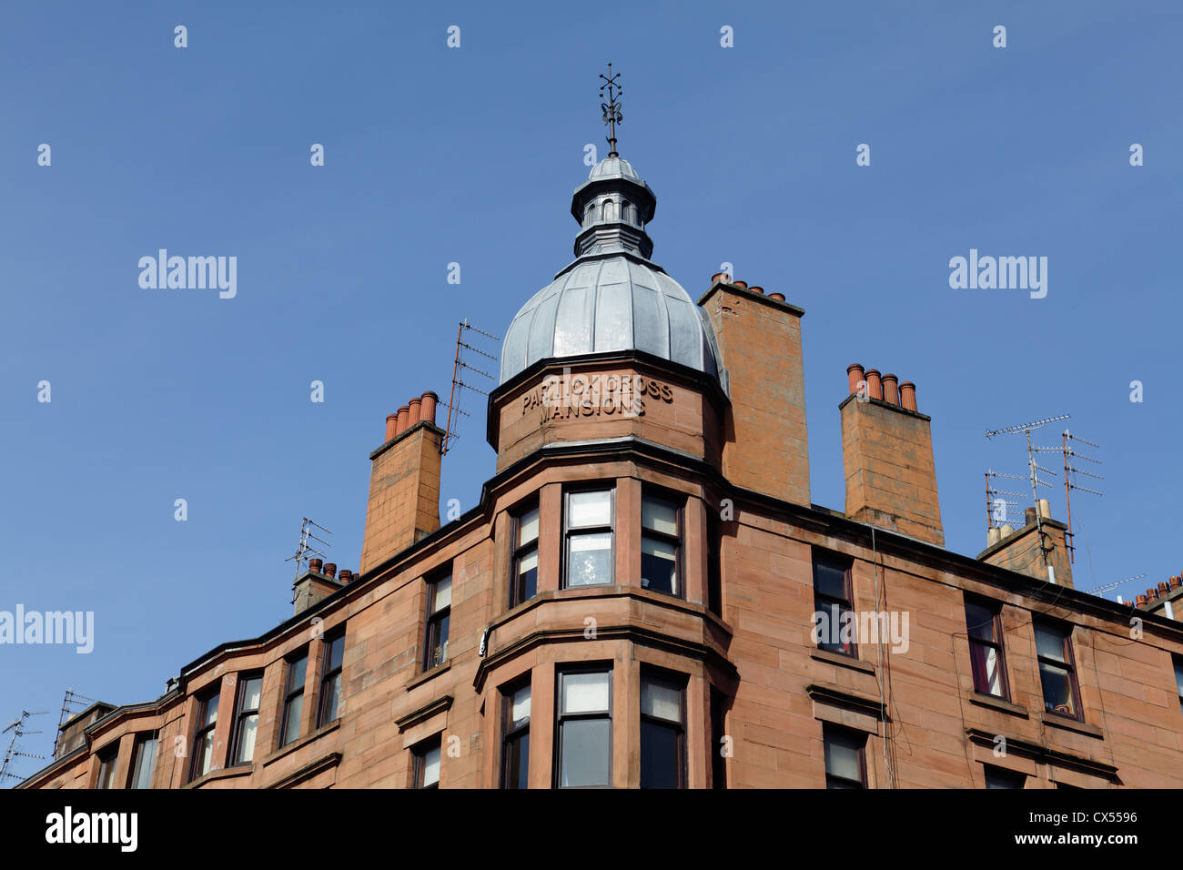 Detail of Partick Cross Mansions tenement housing in the West End of Glasgow, Scotland, UK - Stock Image