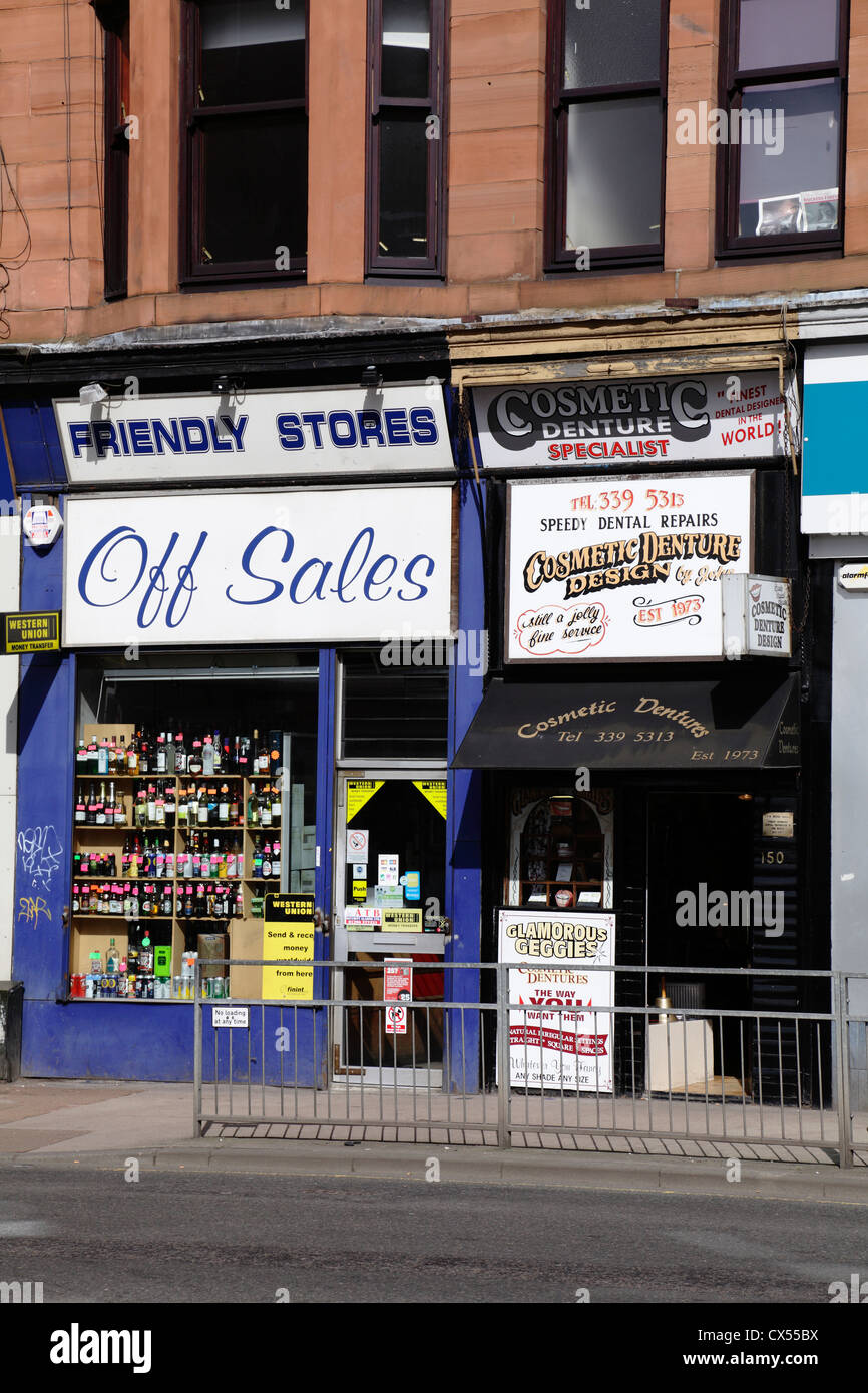 An Off Sales and Cosmetic Dentures Shops on Dumbarton Road in Partick in the West End of Glasgow Scotland UK - Stock Image