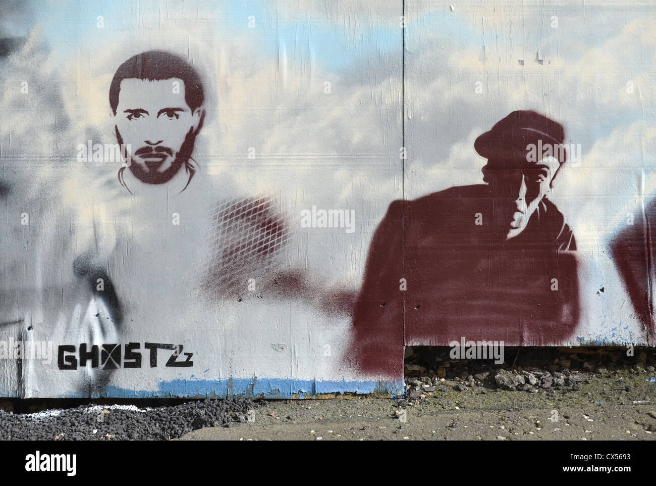 Stencil graffiti on boards on New Street, Edinburgh, Scotland, UK. - Stock Image