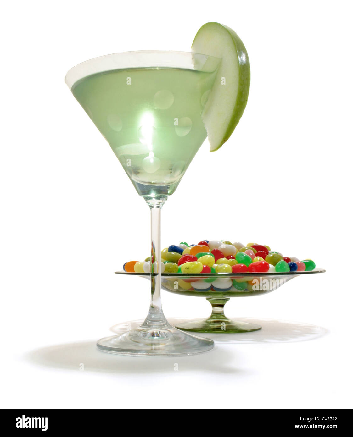 Apple Martini and Jellybeans in a dish photographed on a white background - Stock Image