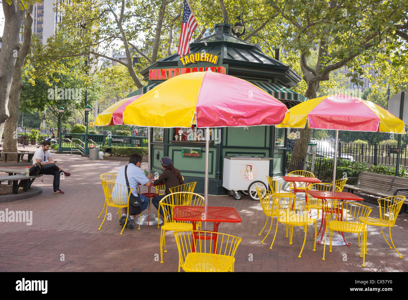 A fast-food stand with cafe tables near City Hall in New York City - Stock Image
