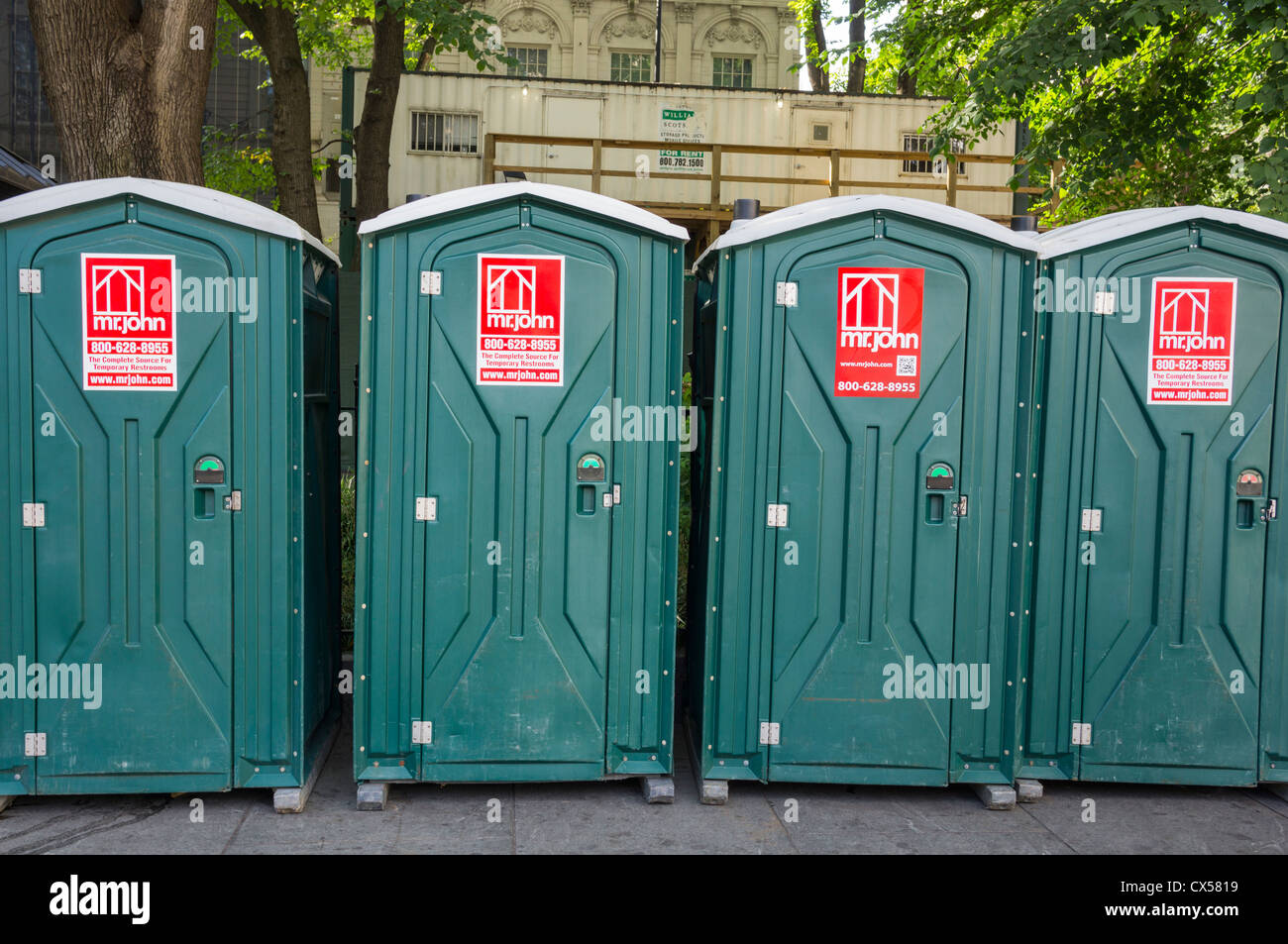 A line of public restrooms in a pocket park between City Hall and the Manhattan entrance to the Brooklyn Bridge - Stock Image