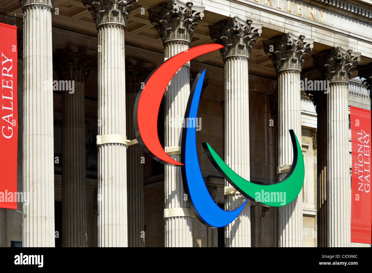Paralympic logo mounted on the columns of the National Gallery in Trafalgar Square London England UK - Stock Image