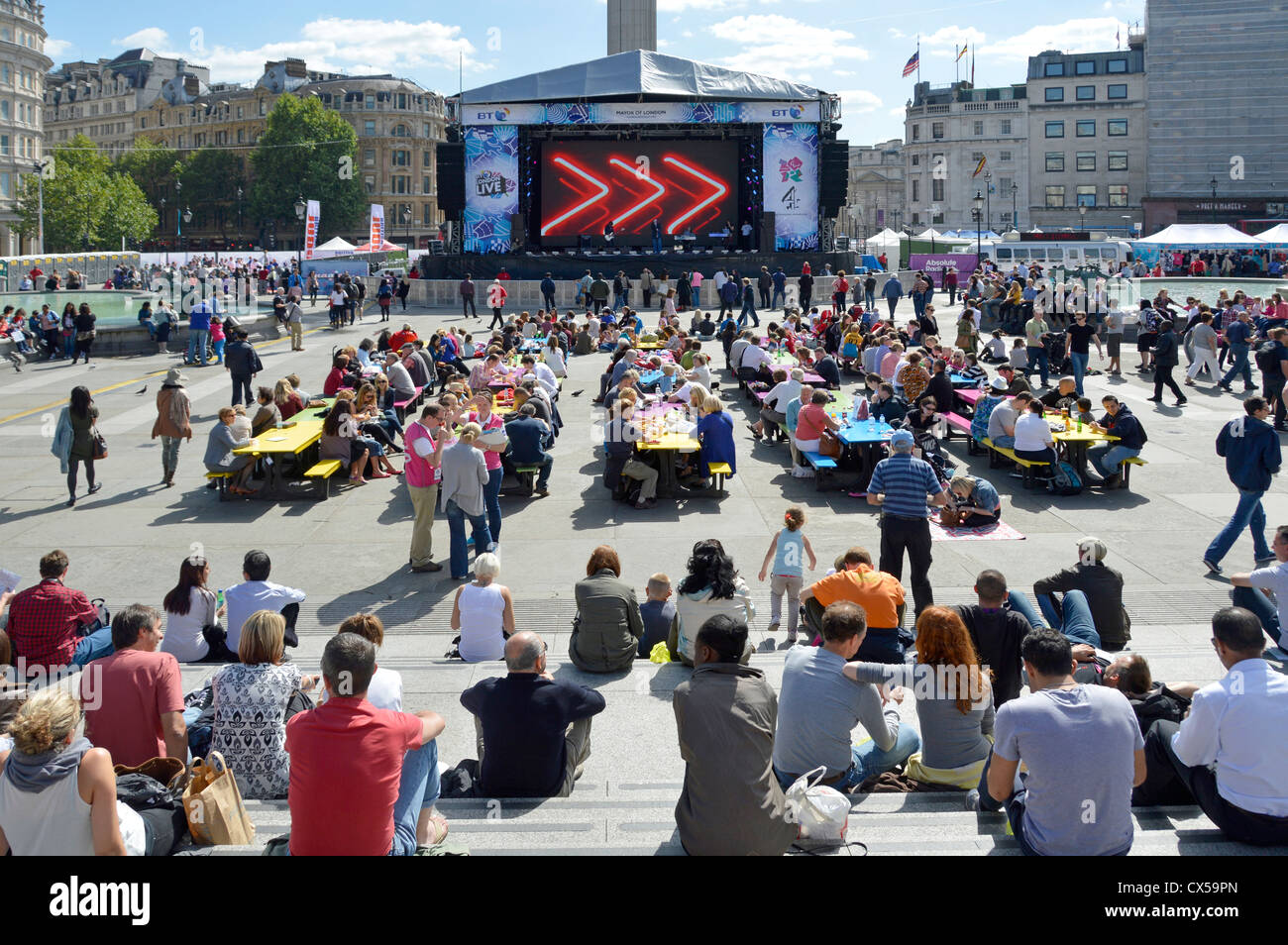 Picnic Tables placed in Trafalgar Square in front of large TV screen and stage during London 2012 Olympic and Paralympic Stock Photo