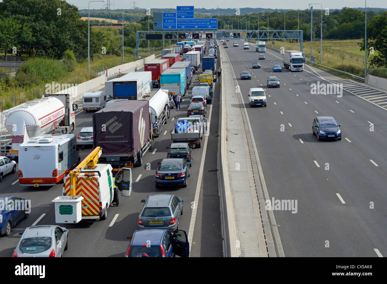 Stationary traffic gridlocked on four lanes of M25 motorway - Stock Image