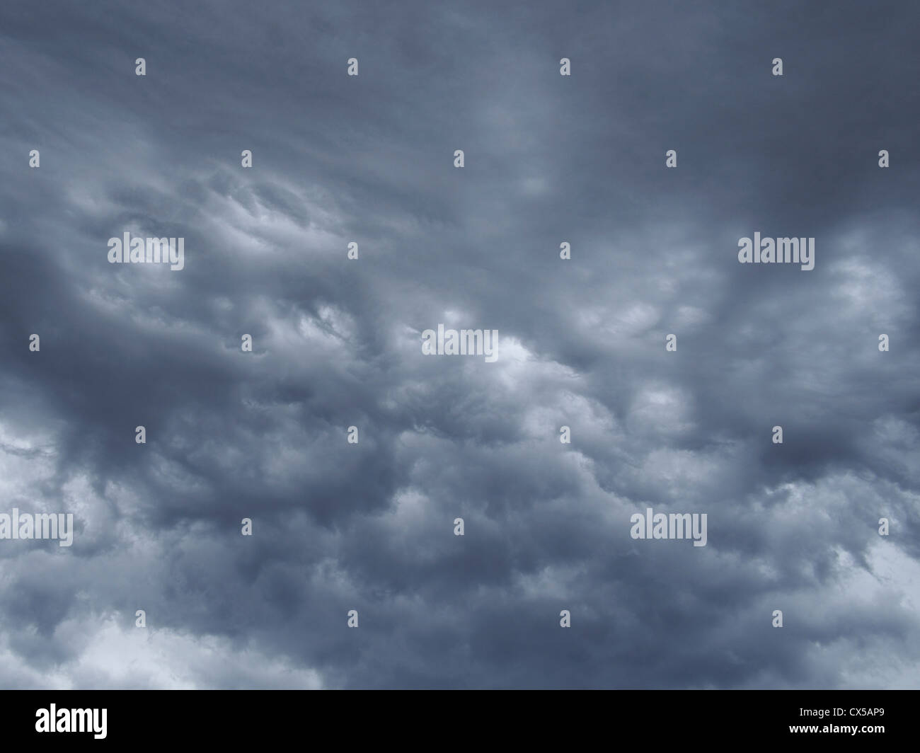 Instability in thundercloud, called mammatus. - Stock Image