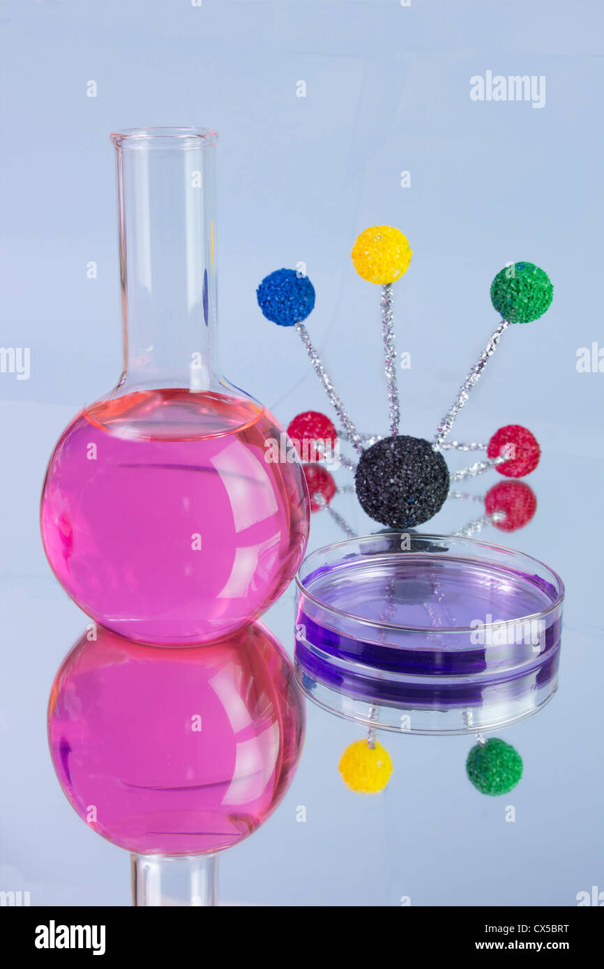 pink flash with molecular model and petri dish with reflections - Stock Image