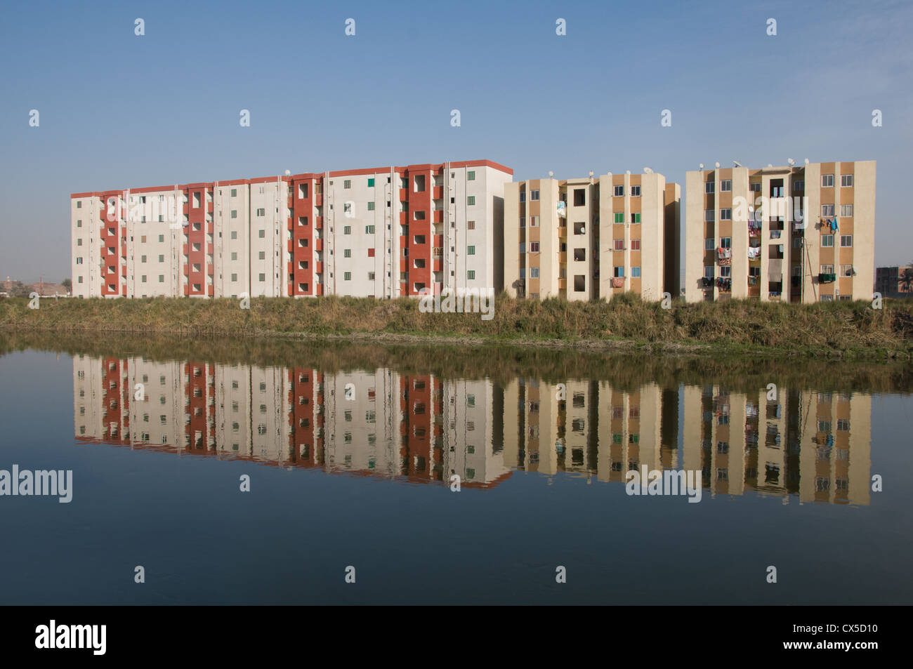 Buildings with apartments on the shore of the Nile River Minya Upper Egypt - Stock Image