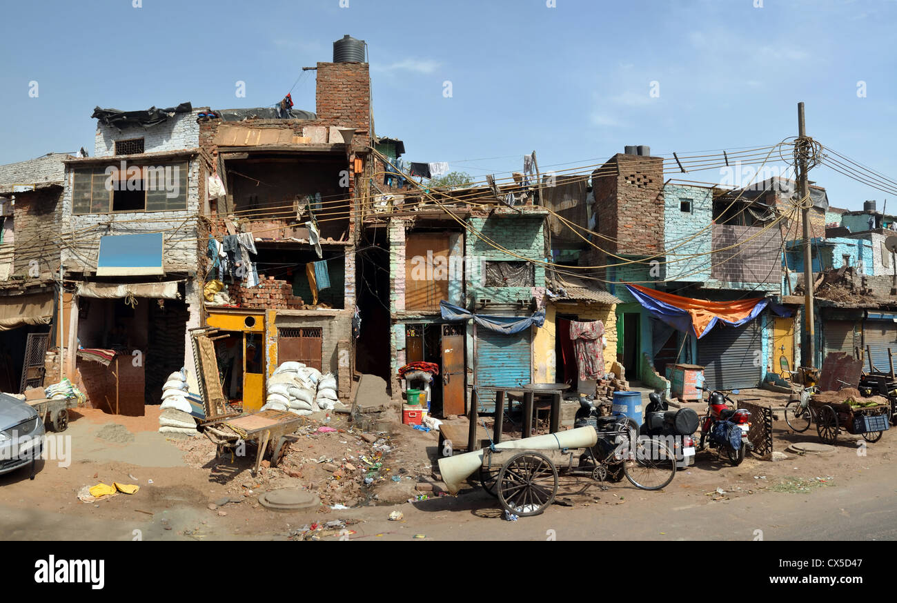 Panoramic view of a row of shops, businesses and houses in old Delhi, India. Stock Photo