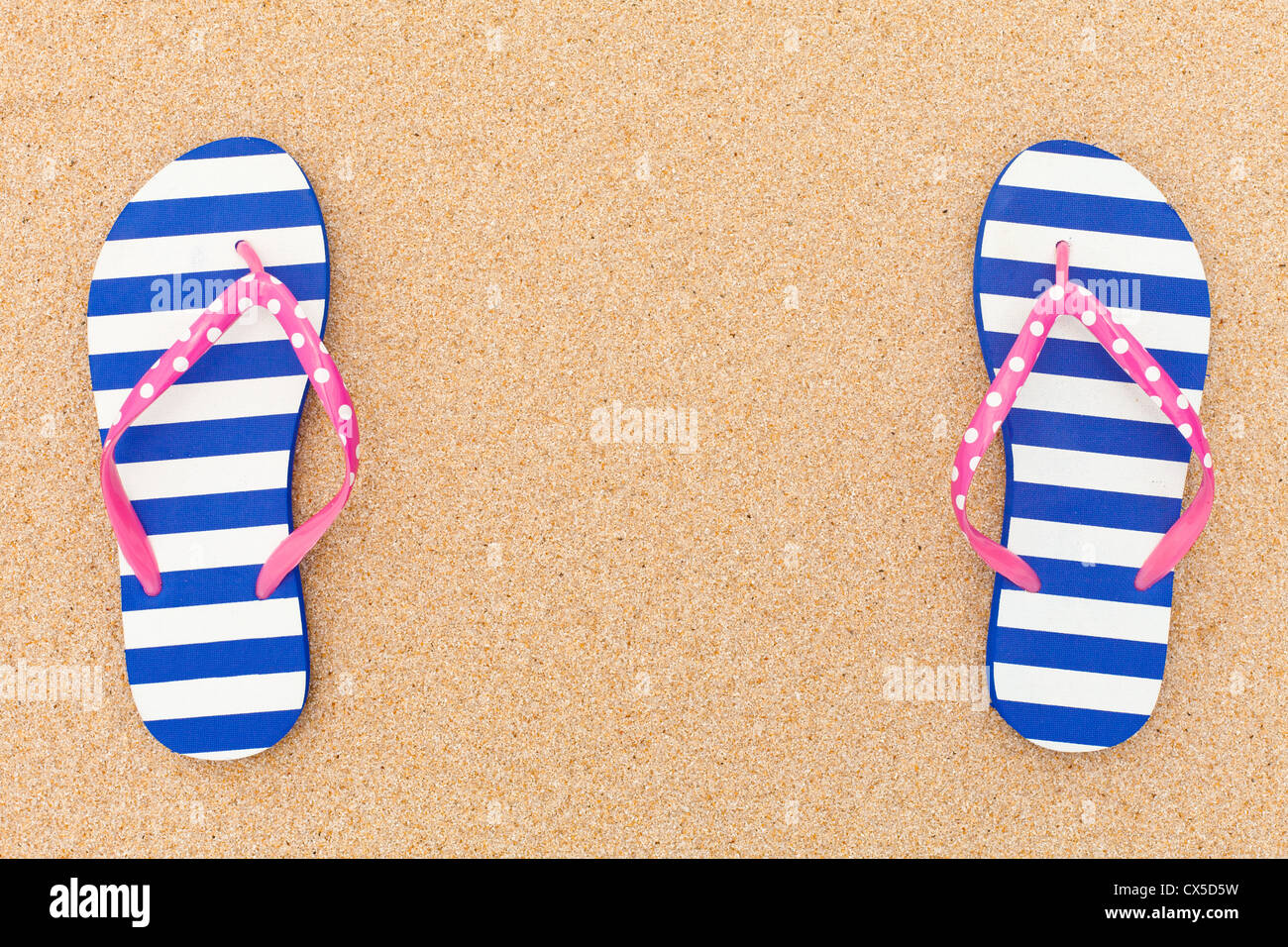 Colorful flipflop pairas a frame on beach sand Stock Photo: 50521909 ...