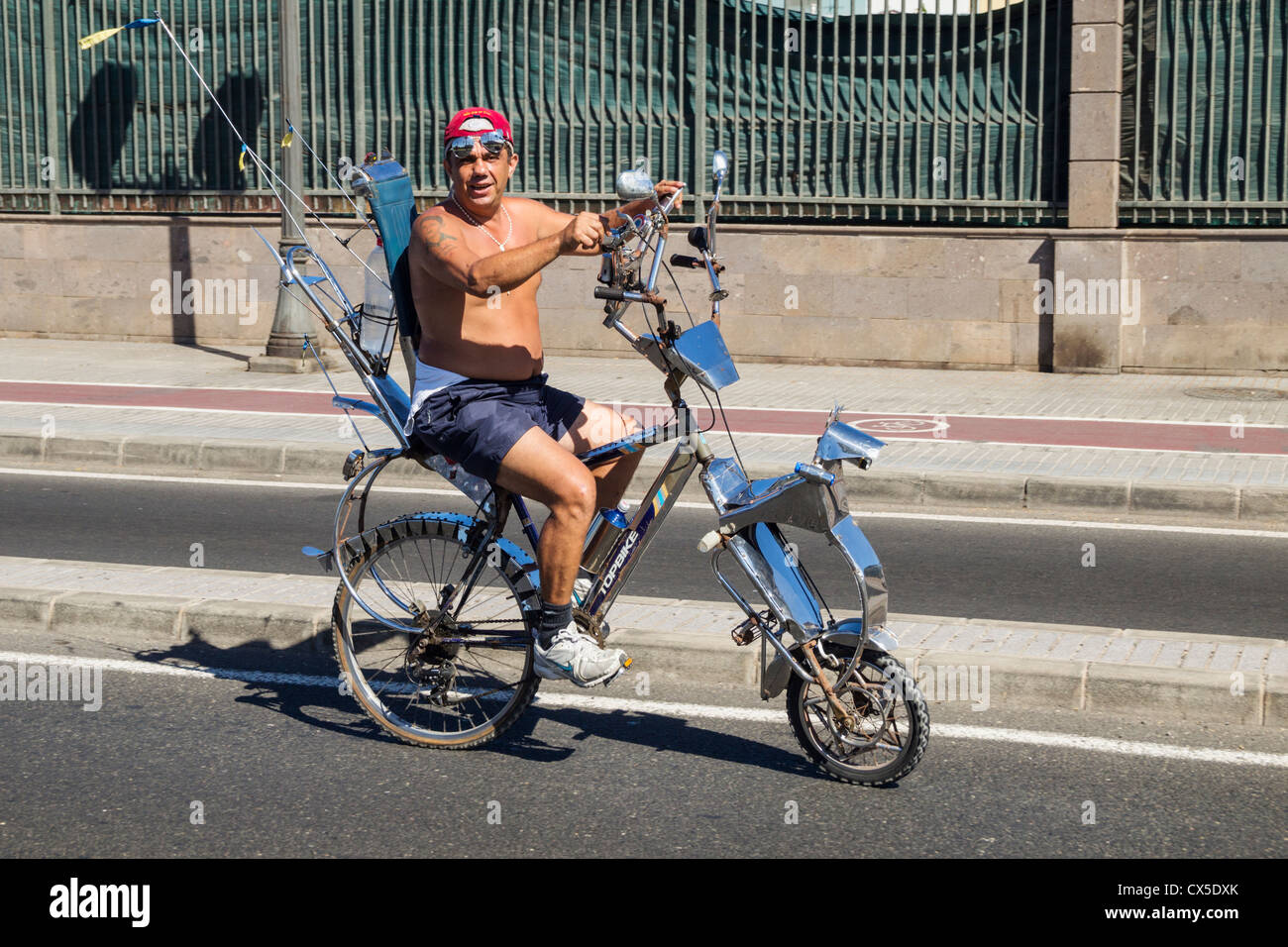 Man riding custom built bicycle in Spain - Stock Image