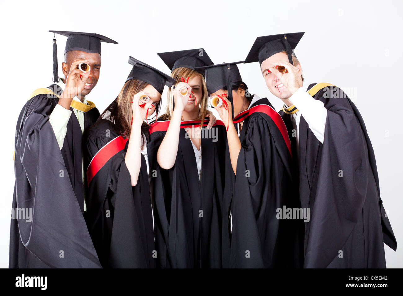 group of graduates looking through their diploma - Stock Image