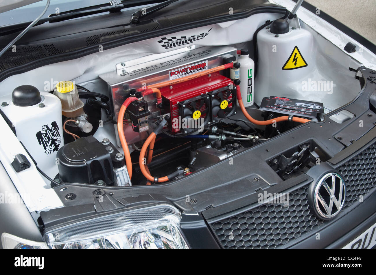 Car with bonnet up showing electric VW engine on display at an Eco Car Exhibition. UK. - Stock Image