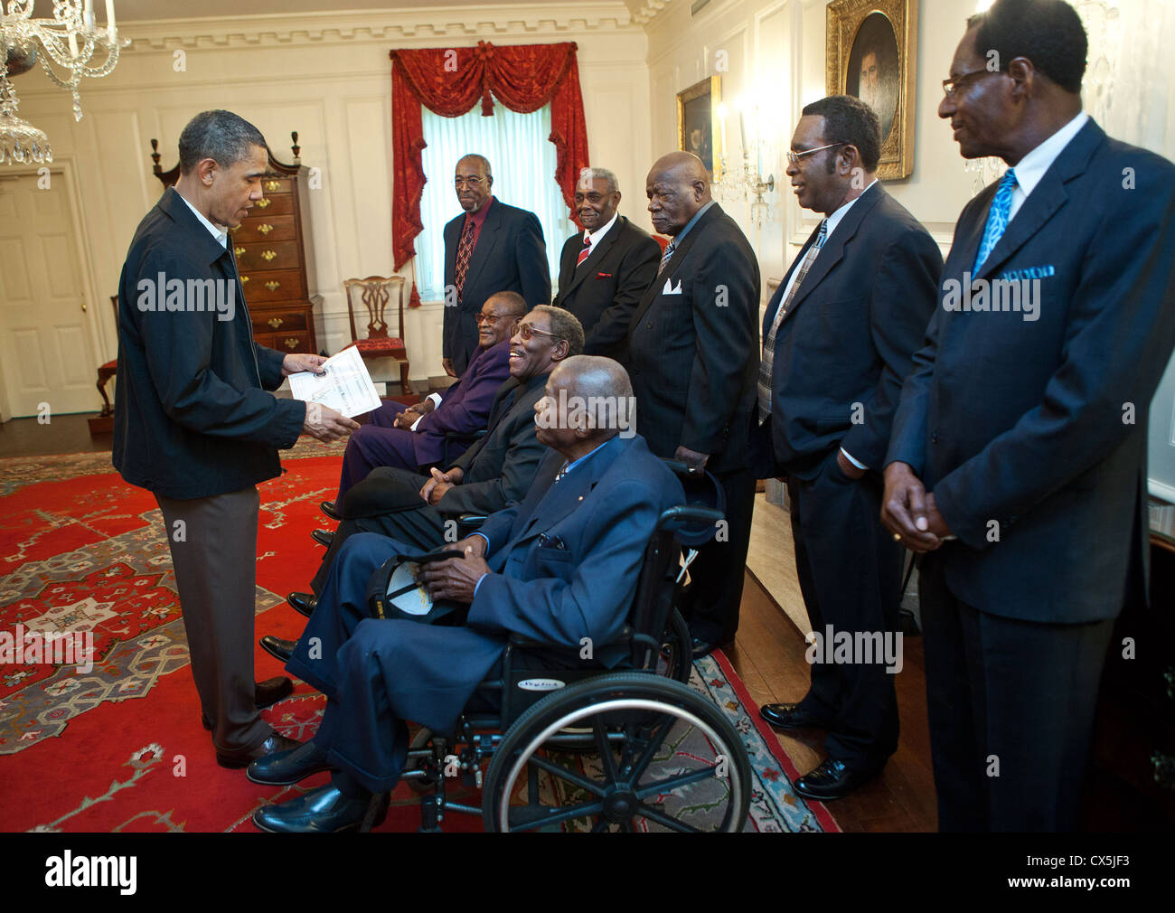 US President Barack Obama talks with participants from the 1968 Memphis sanitation strike, an iconic campaign in - Stock Image