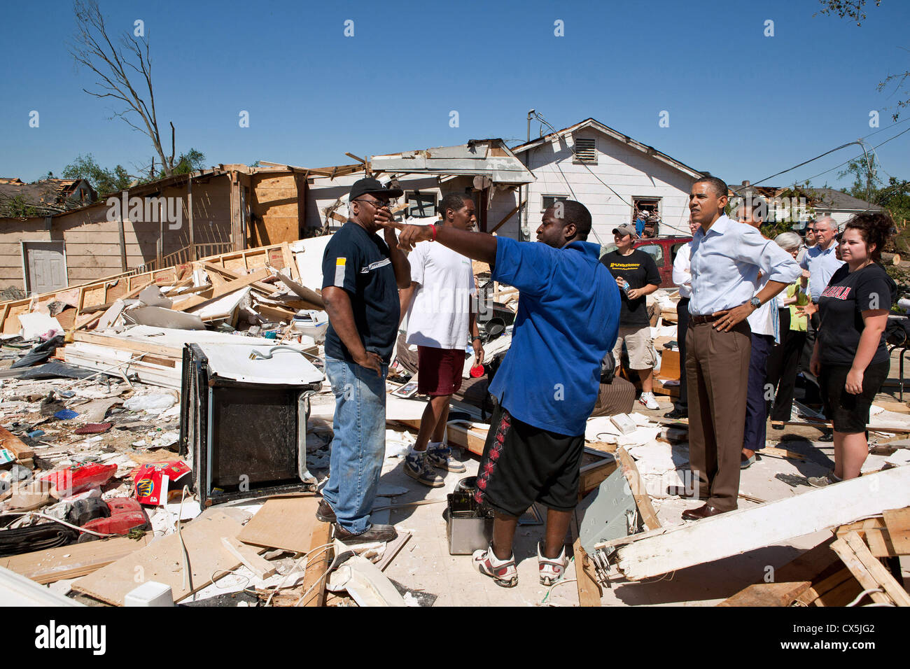 US President Barack Obama and First Lady Michelle Obama inspect tornado damage with residents of the Alberta neighborhood - Stock Image