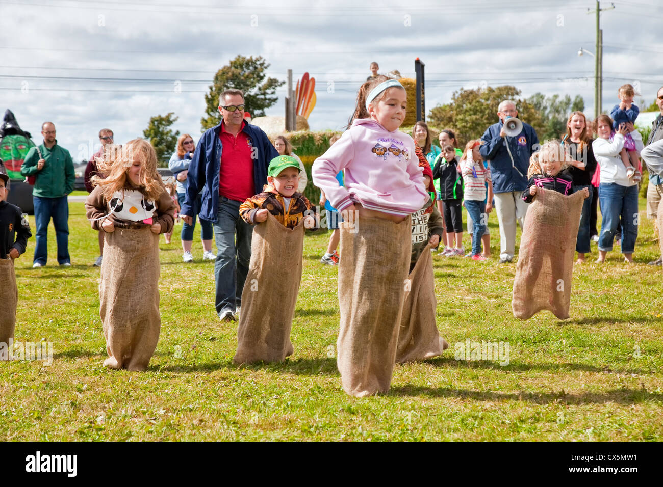 Kids in the potato sack race at the annual Scarecrow Festival held in Summerside, Prince Edward Island, Canada. - Stock Image