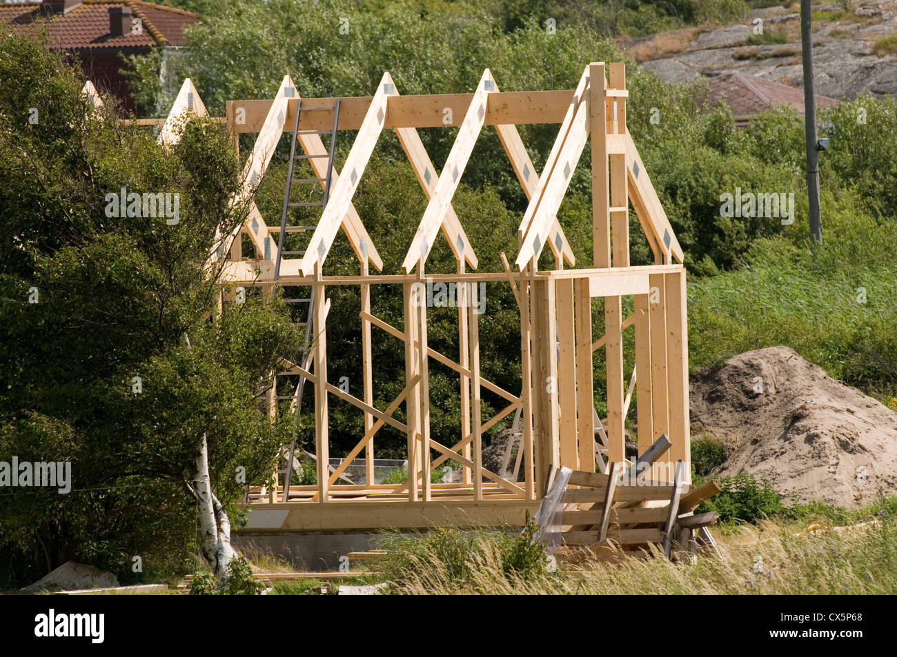 timber house houses home homes frame framed wood wooden under construction building buildings sweden swedish pine Stock Photo