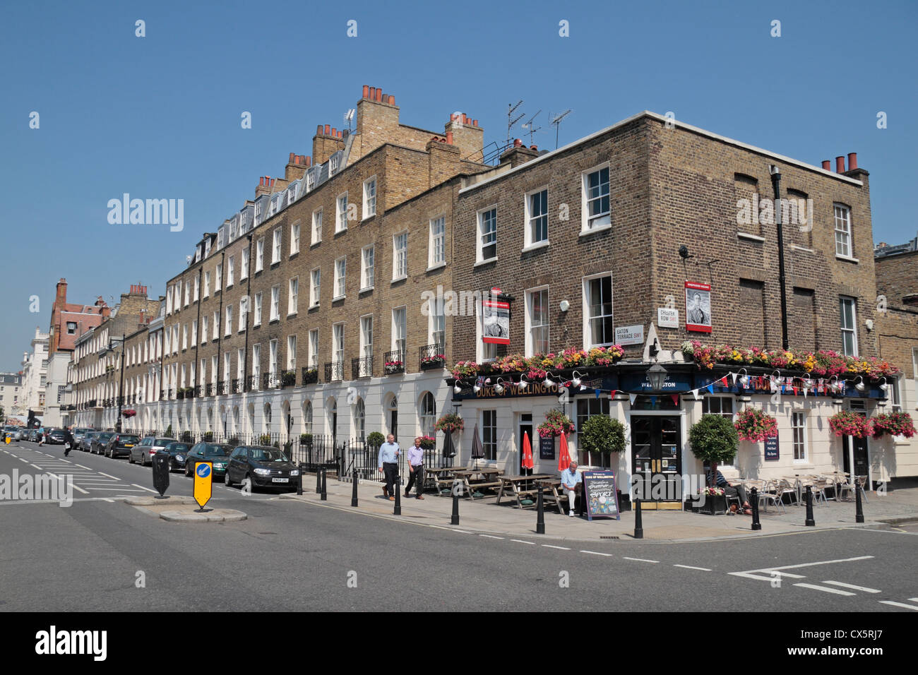View down Eaton Terrace with the Duke of Wellington public house, City of Westminster, London, SW1, UK. - Stock Image
