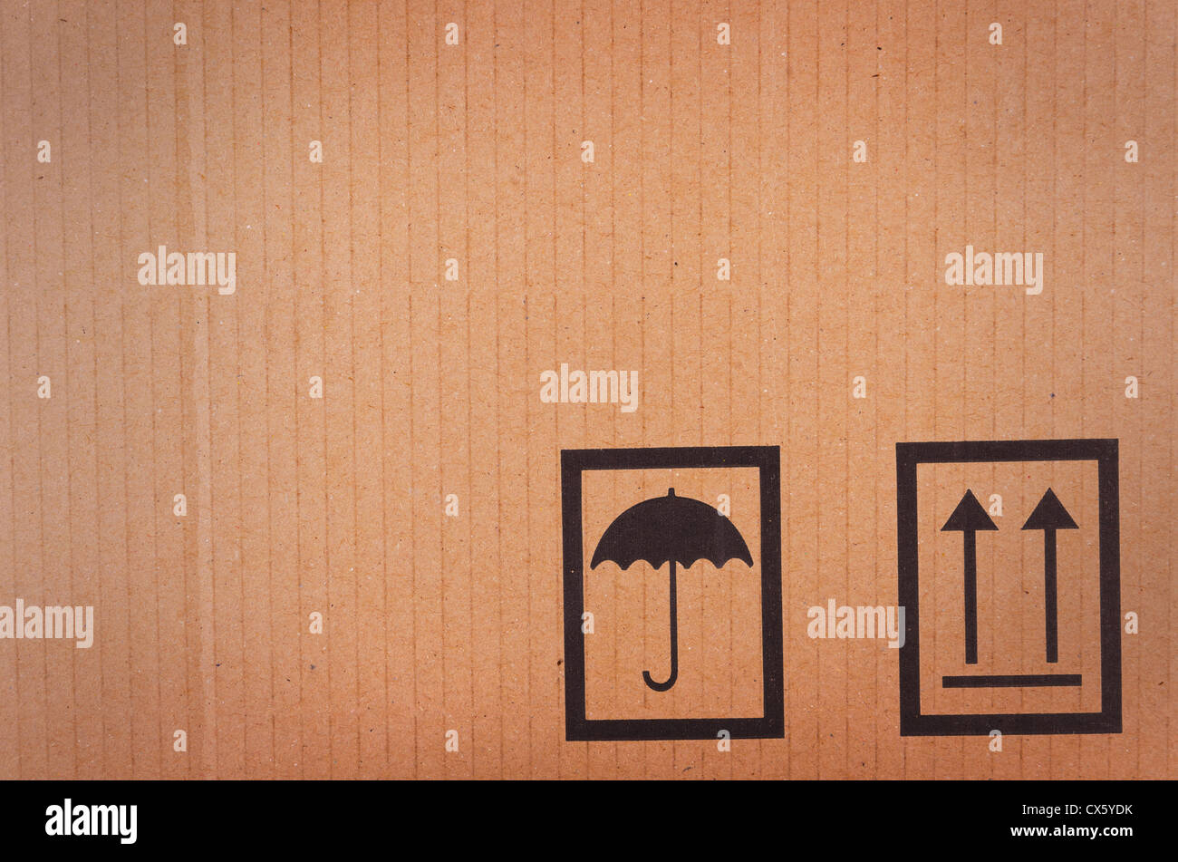 Cardboard background with shipping icons - Stock Image