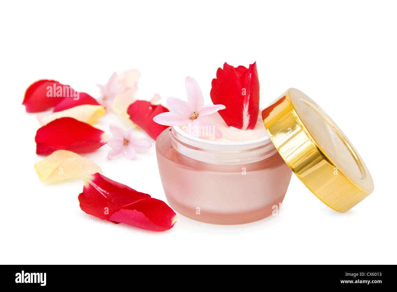 Natural face cream with roses. Isolated over white background. - Stock Image