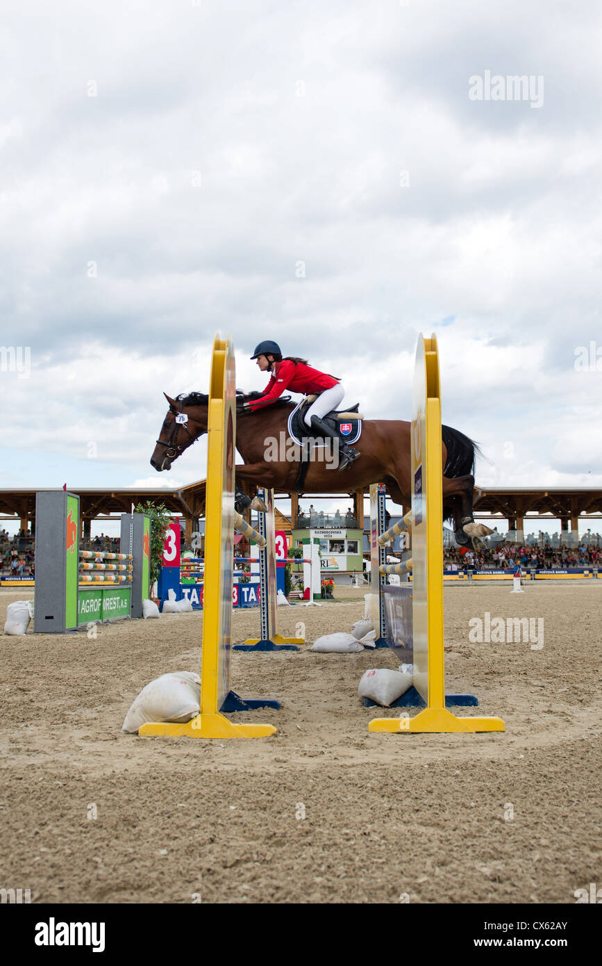 PEZINOK, SLOVAKIA - SEPT. 8 2012: Jana Slavikova on horse Balance jumps over hurdle on GP Postova Banka-Peugeot - Stock Image