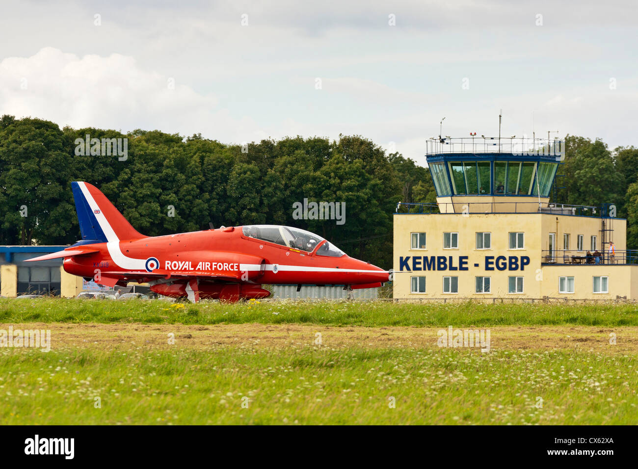 RAF Hawk Red Arrows display team aircraft on the runway passing the Kemble EGBP Control Tower. JMH6105 Stock Photo