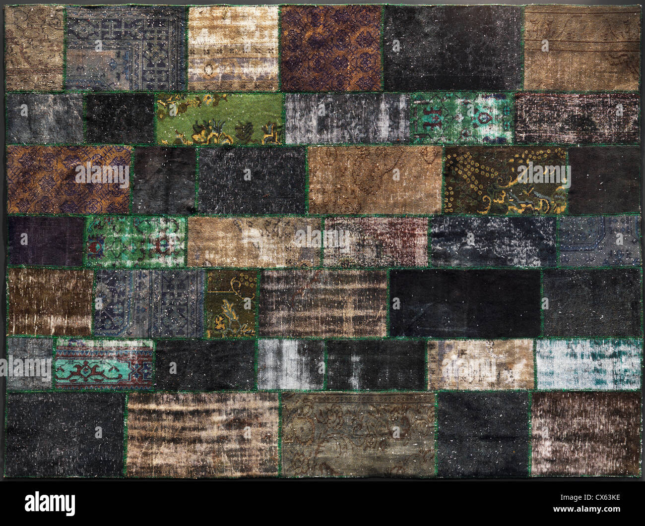 Carpet made of colorful patches of recycled vintage rugs - Stock Image