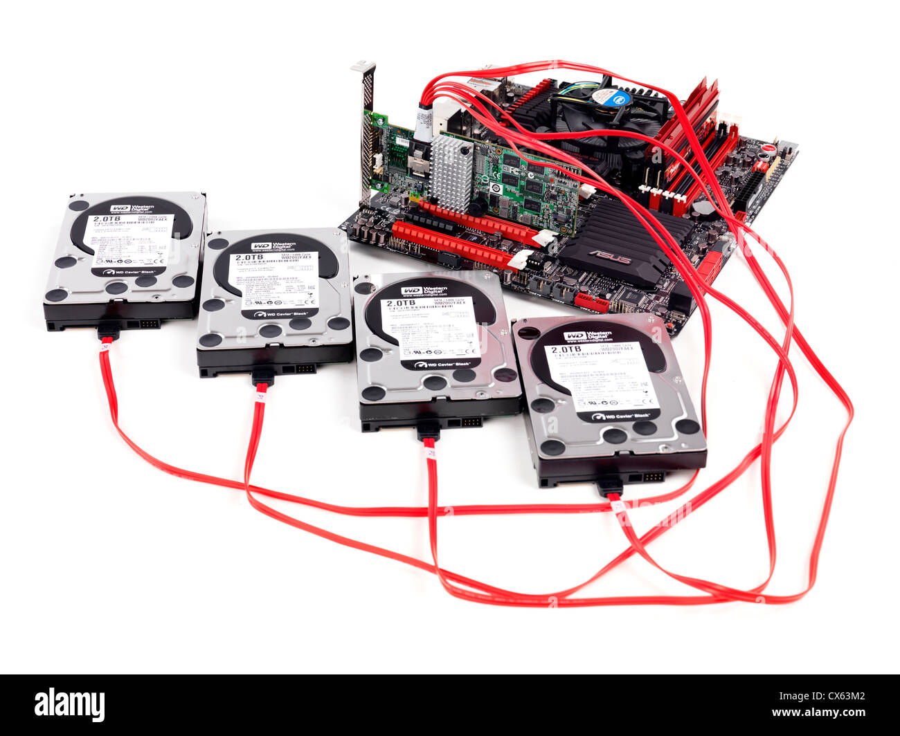 Hard drives connected to computer motherboard with a RAID controller isolated on white background - Stock Image