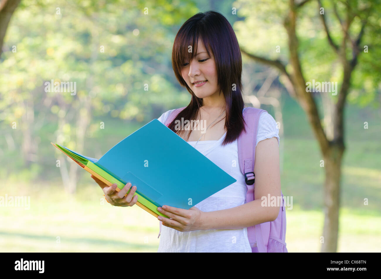 outdoor asian college girl Stock Photo