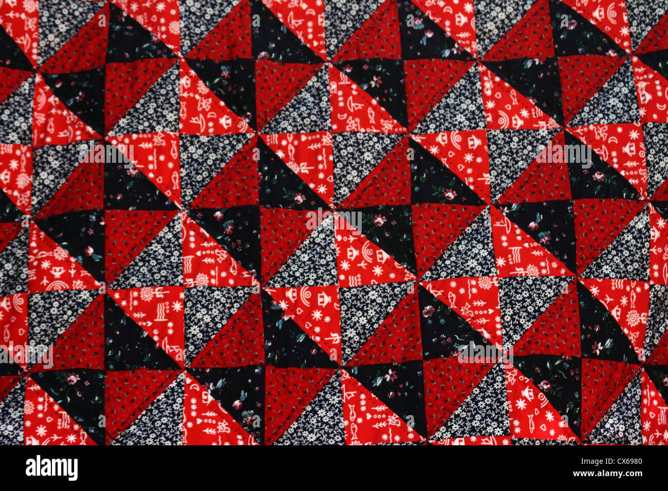 hand made crazy quilt - Stock Image