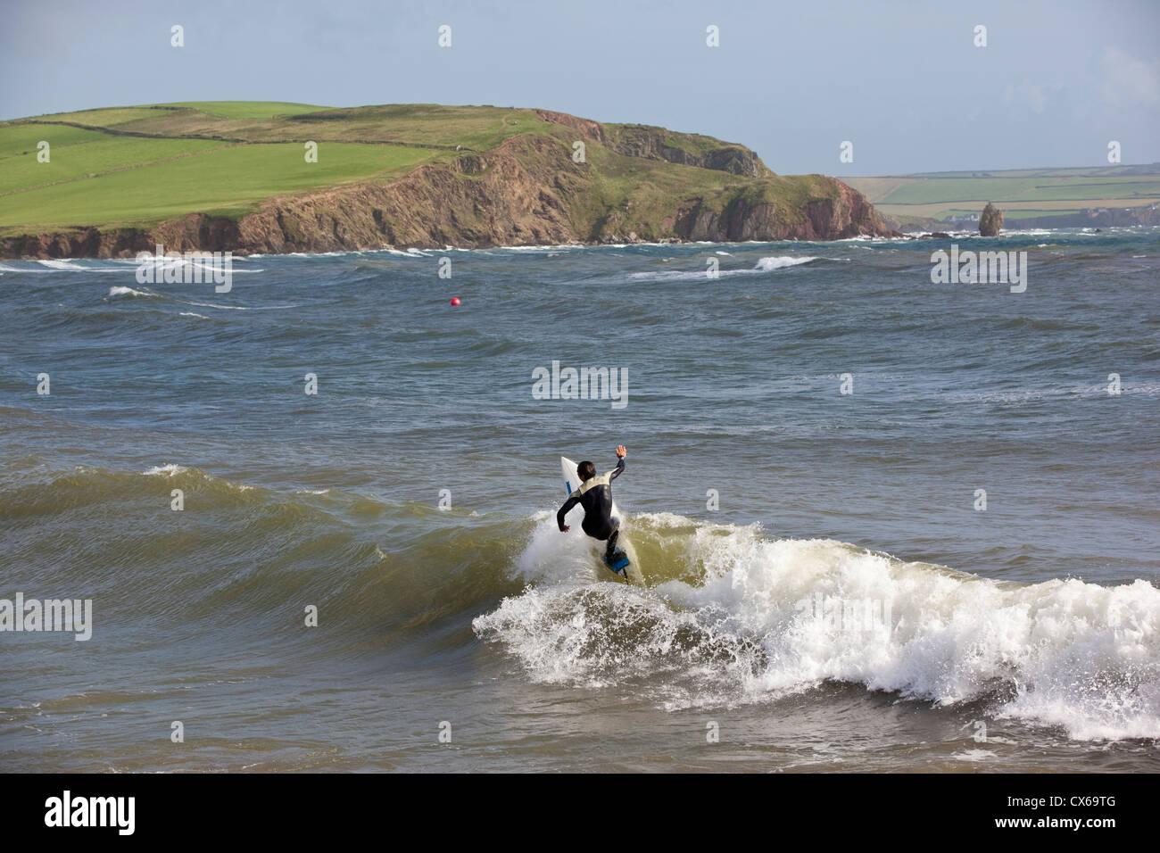 Surfer at Bigbury-On-Sea on the south coast of Devon, South Hams, England, UK - Stock Image