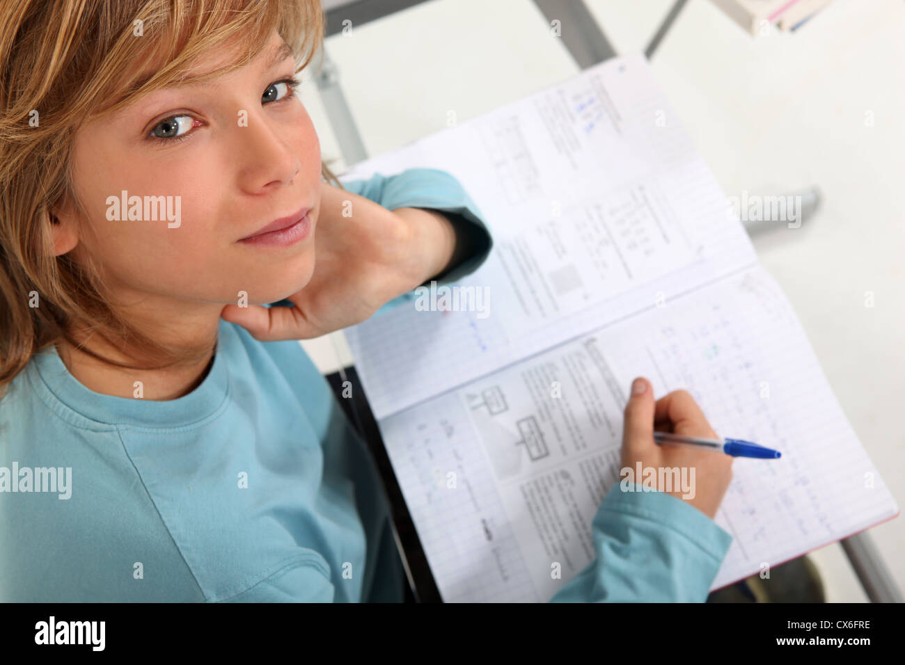Prepubescent boy sitting an exam - Stock Image