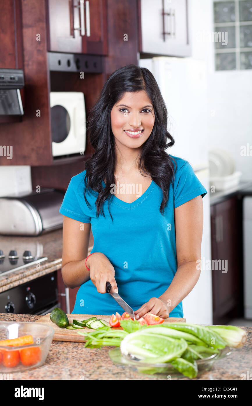 young Indian woman cooking in kitchen Stock Photo: 50546161 - Alamy