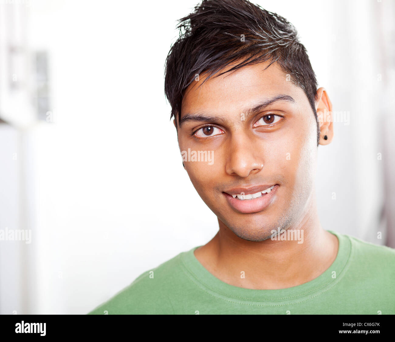 Handsome young indian man closeup portrait