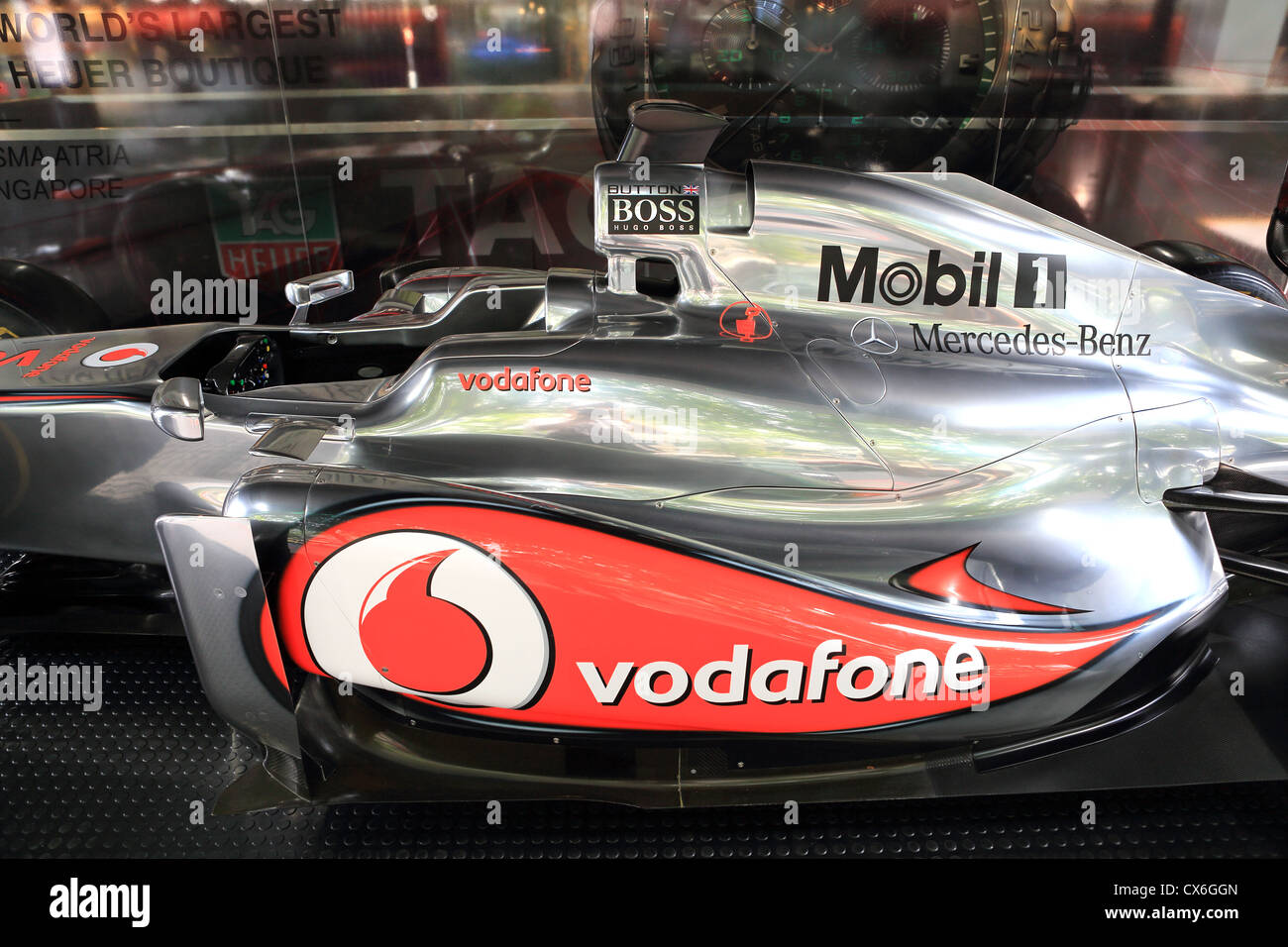 fcff70eeb75 Jenson Button s McLaren Mercedes Formula One racing car on display in  Singapore before the 2012 Singapore