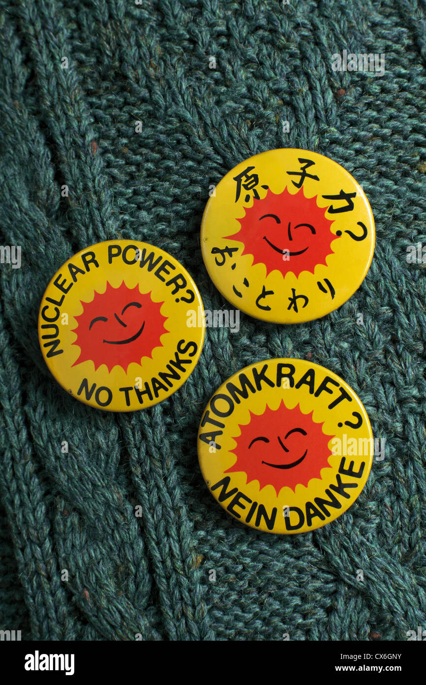 Person wearing three anti-nuclear power badges, reading 'Nuclear Power? No Thanks' in English, German and - Stock Image