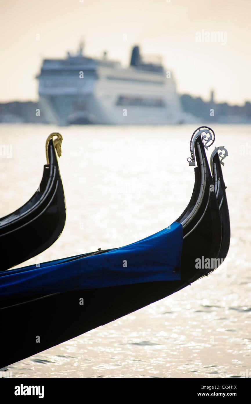 A big Cruise sails in front of Gondolas,Venice, Italy. - Stock Image